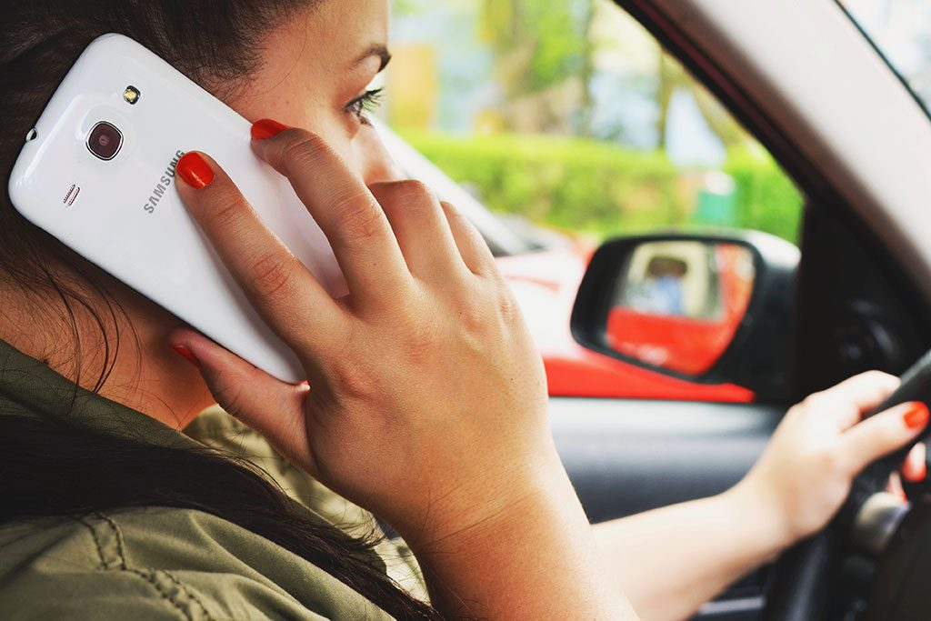Woman Using Her Mobile While Driving