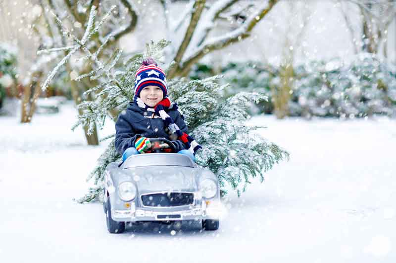 Boy In A Toy Car At Christmas