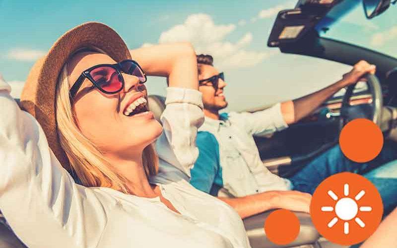 couple-driving-sun